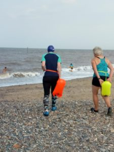 Two old ladies walking towards the sea, as if to swim in it